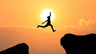 Courage man jump through the gap between hill ,Business concept idea
